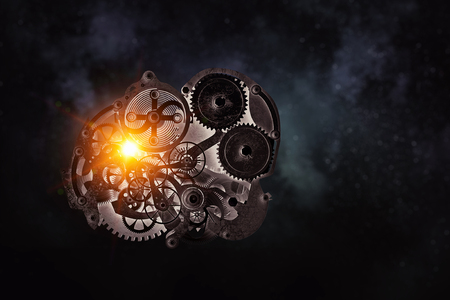 Gears and cogwheels mechanism floating in air. Mixed media Фото со стока