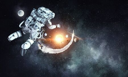 Astronaut floating in outer space 版權商用圖片