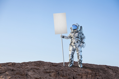 Astronaut holding blank banner for advertise. Mixed media