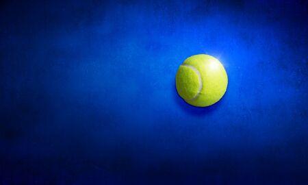 Big tennis yellow ball on blue background Standard-Bild