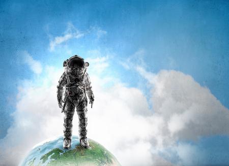 Space explorer in astronaut suit. Mixed media.