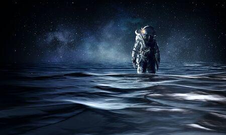 Astronaut in space suit standing in water. Mixed media