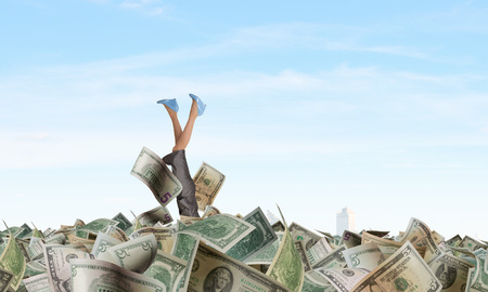 Rich businesswoman dive in pile of money banknotes