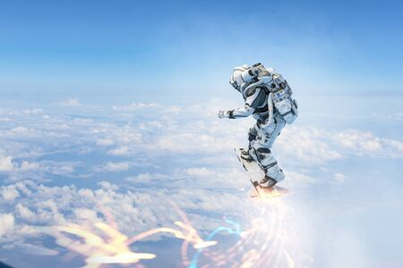 Astronaut flying on futuristic rocket skateboard in blue sky. Mixed media