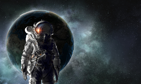 Astronaut in outer space against abstract background.
