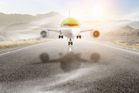 Airplane landing on asphalt road. Mixed media