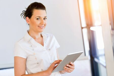 Smiling woman with tablet pc