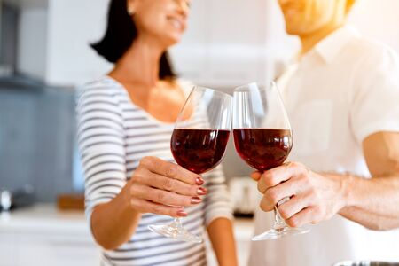 Portrait of a couple having a glass of red wine Stock Photo
