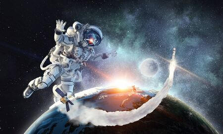 Astronaut floating in outer space. Elements of this image furnished by NASA