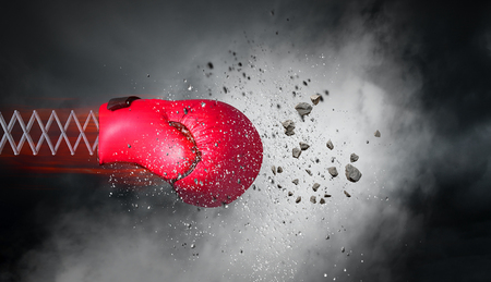 Boxing glove on spring on dark sky background. Mixed media Stockfoto