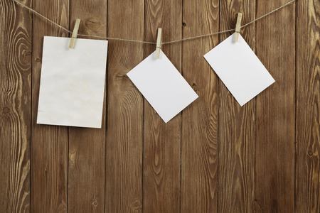 Blank sheets of paper hanging on rope