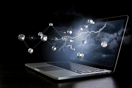 Opened laptop on dark background and metal conection grid. 3d rendering Stock Photo