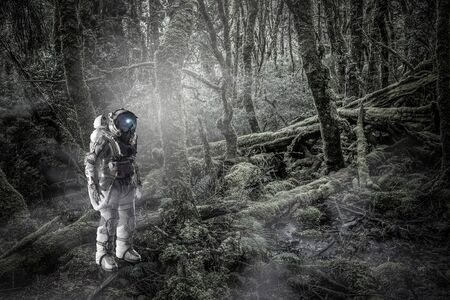 Space explorer in astronaut suit at forest. Mixed media