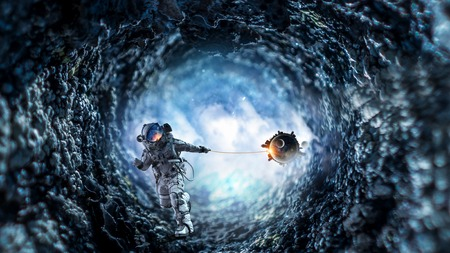 Fantasy image with spaceman catch planet. Mixed media Reklamní fotografie