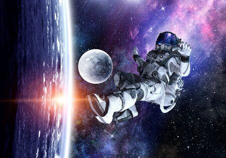 Astronaut floating in open space. Mixed media Stock fotó
