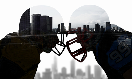 Double exposure of cityscape and rugby players. Mixed media