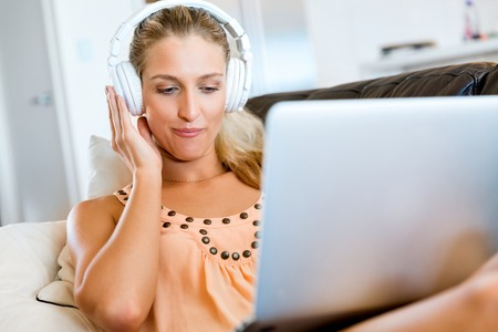 Young beautiful woman working on her laptop Stock Photo