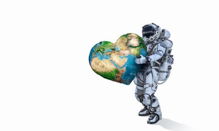 地球の惑星を手に運ぶ宇宙飛行士。 写真素材