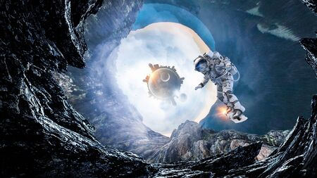 Fantasy image with astronaut in space hole Banque d'images