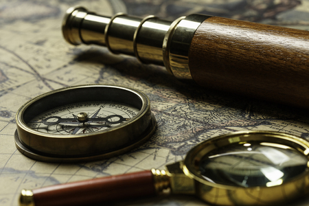 Concept of travel and discovery with old map and compass on it Reklamní fotografie