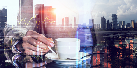 Double exposure of businesswoman hand with coffee cup and modern cityscape