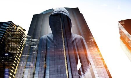 Double exposure of man in hoody and city on white background