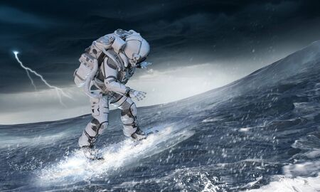 Spaceman sur flying board surfant sur la mer. Technique mixte Banque d'images
