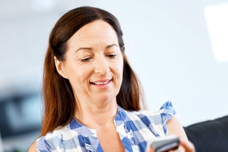 Portrait of woman holding phone