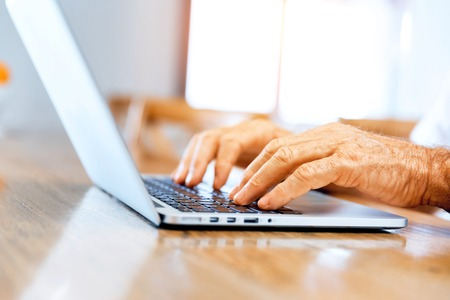 Close-up of typing male hands
