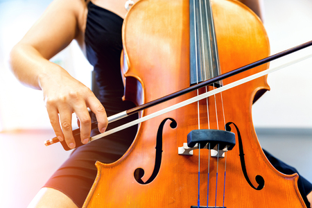 Close up of cello with bow in hands Banque d'images