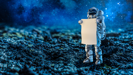Astronaut in space holding white blank board. Mixed media Imagens - 93874363