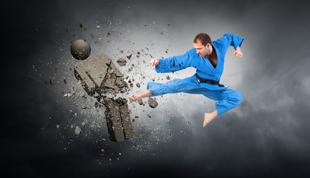 Karate man attack opponent. Mixed media Banco de Imagens