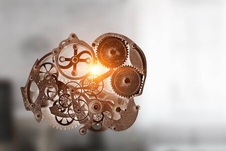 Gears and cogwheels mechanism floating in air. Mixed media Stock Photo