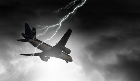 Lightning in sky striking airplane. Mixed media