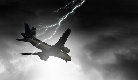 Lightning in sky striking airplane. Mixed media