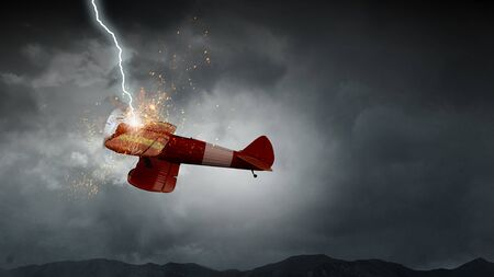 Lightning striking retro plane flying in dark sky. Mixed media
