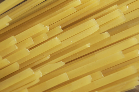 Dry spaghetti pasta on table ready for cooking