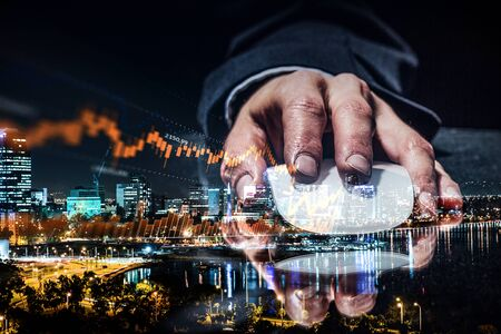Double exposure of hand with mouse and modern cityscape Stock Photo