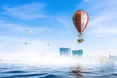 Color aerostat flying above sunken city. Mixed media
