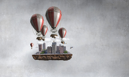 Mini city exterior flying in concrete room on aerostats. Mixed media