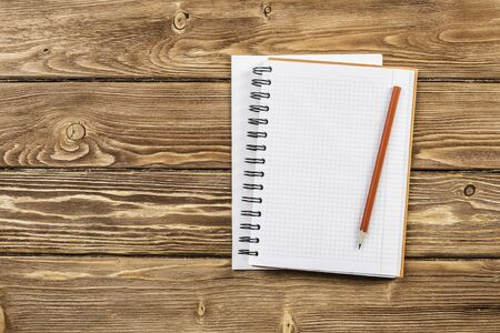 Top view of two notepads with pencil on wooden background Stok Fotoğraf
