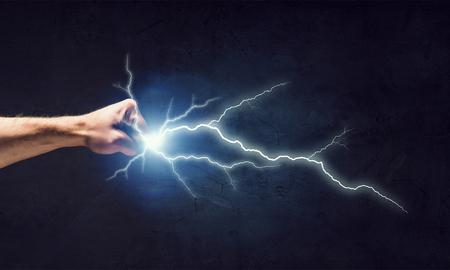 Close-up of human fist strike lightning flash