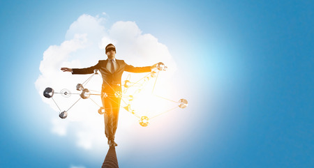 Businessman with blindfolder on eyes walking on rope high in sky. 3d rendering