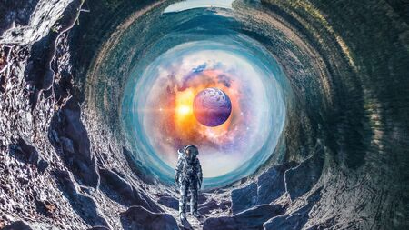 Fantasy image with astronaut in space hole.