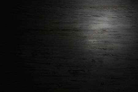 Wooden blank background or texture with spot of light Imagens