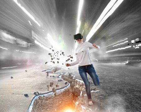 Woman in helmet experiencing virtual reality. Mixed media Stok Fotoğraf