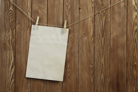 Blank sheet of paper hanging on rope