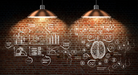 Business plan sketch drawn on wall with lamps hanging above it