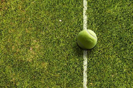Big tennis ball on line of field Reklamní fotografie