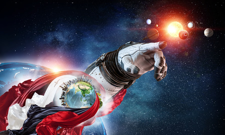 Close of astronaut robotic hand touching planet. Stock Photo
